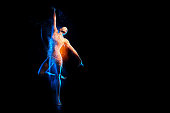 Fine art portrait of beautiful woman dancer in blue sparkles. Mixed lighting photography.