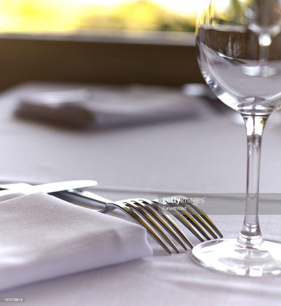 Fine dining restaurant table setup - Fine Dining Restaurant Dinner Table Place Setting Napkin Wineglass Stock Photo