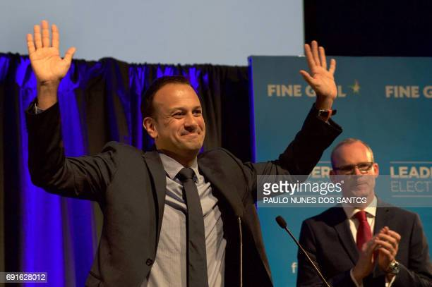 Fine Gael TD for Dublin West and Minister for Social Protection Leo Varadkar celebrates victory as Irish Minister for Housing Simon Coveney looks on...