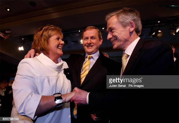 Fine Gael leader Enda Kenny with his wife Fionnuala and Deputy leader Richard Bruton after he delivered his presidential address at the Citywest...