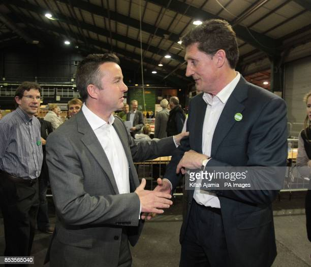 Fine Gael MEP Brain Hayes shakes hands with Green Party candidate Eamon Ryan during the European Parliamentary elections count at the RDS in Dublin