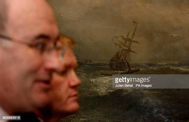 Fine Gael's Phil Hogan and Senator Paudie Coffey in front of a painting of a stormy sea in the Merrion Hotel Dublin during a press conference held by...
