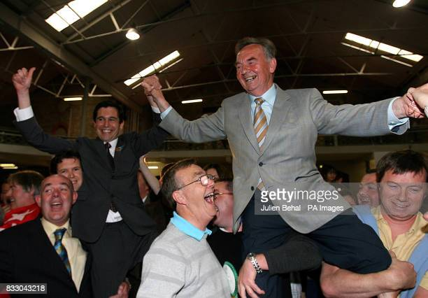 Fine Gael's Terence Flanagan holds hands triumphantly with Fianna Fail's Michael Woods at the RDS in Dublin as all were elected in the Dublin North...
