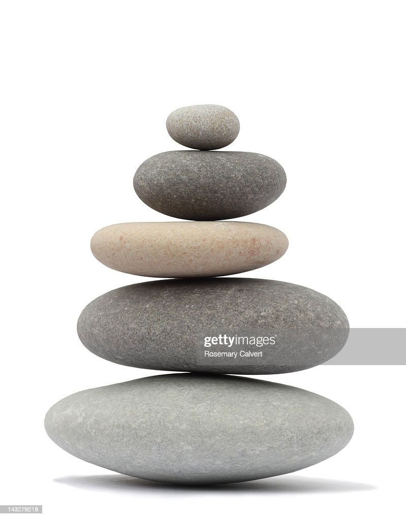 Finely balanced stack of five rounded pebbles : Stock Photo
