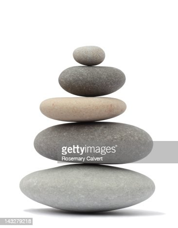 Finely balanced stack of five rounded pebbles
