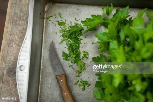 Finely chopped farm fresh parsley on a metal tray