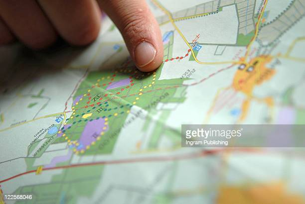Finger pointing on a map