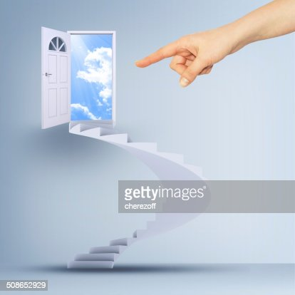Finger pointing to spiral stairs and magic doors : Stock Photo