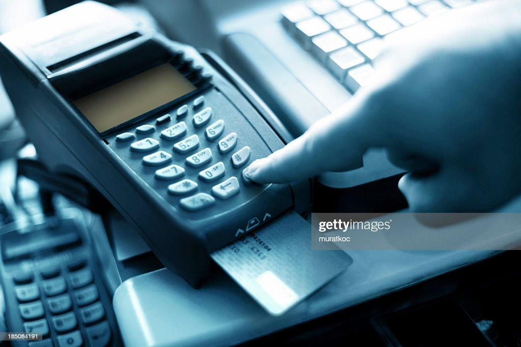 Finger pressing button on bank card reader