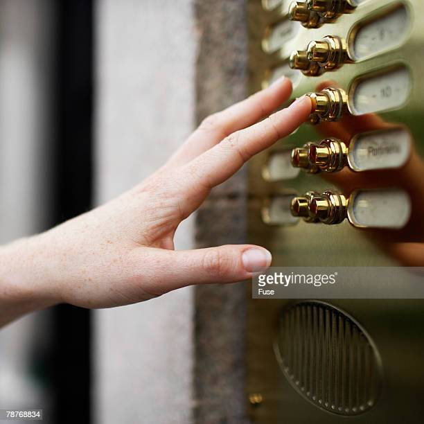 Finger Pushing Bell Button