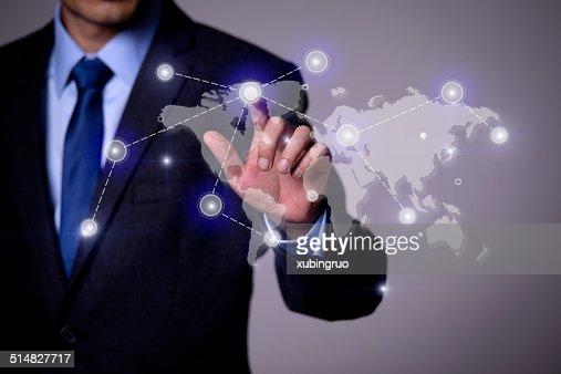 Finger pushing the world map