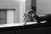 Kid's hand with fingers tapping in black and white
