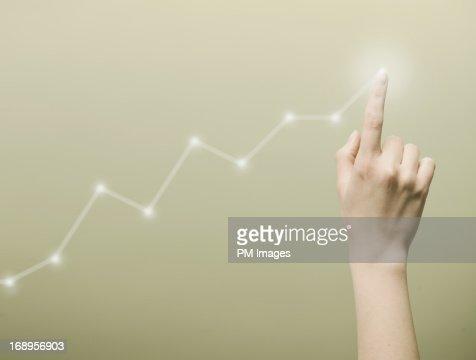 Finger touching chart graph
