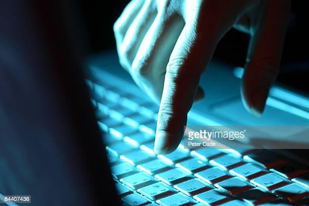 finger touching keyboard
