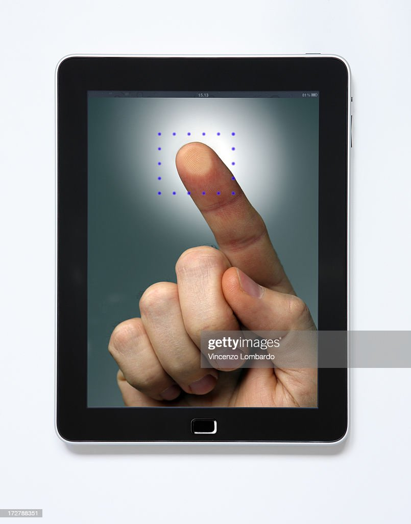 Finger touching the screen : Stock Photo