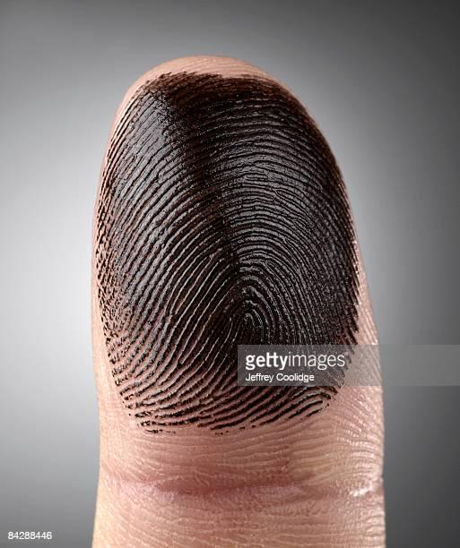 fingerprint ink on finger