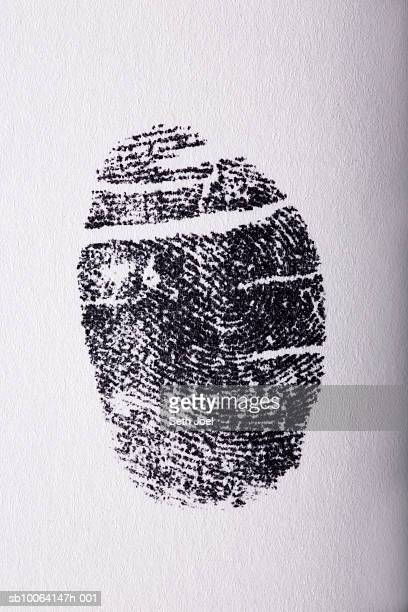 Fingerprint on white paper