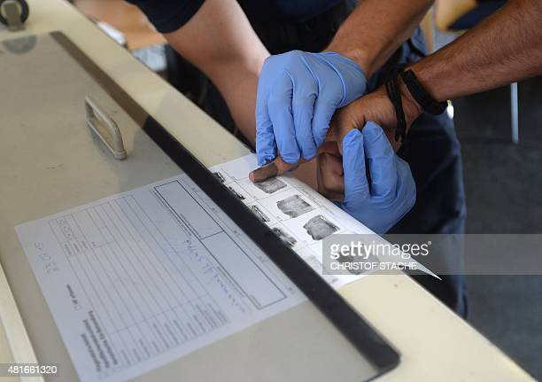 Fingerprints are taken of refugees as they are processed at the first registration point of the German federation police in Passau southern Germany...