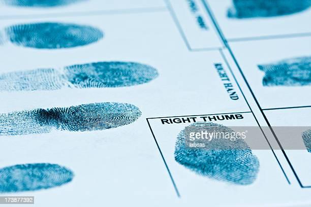 Fingerprints on authentic fingerprint form. Toned image.