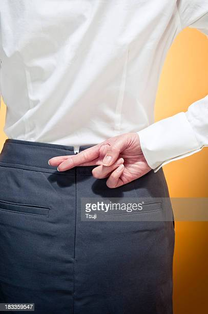 Fingers crossed businessman