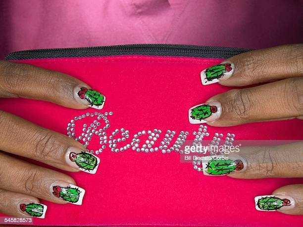 Fingers with Painted Nails of a Young Woman