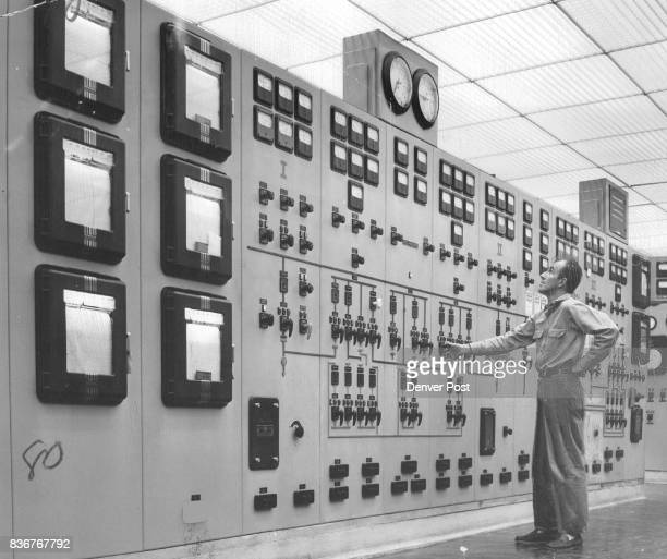 Neil Roberts control room operator looks over the big control board at the 132millionwatt steamelectric generating plant Power from the plant can...