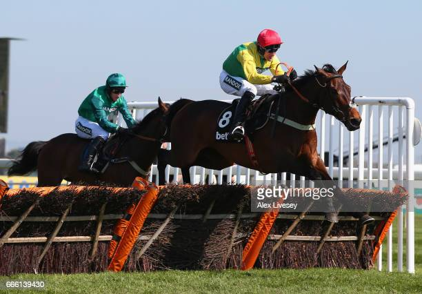 Finian's Oscar ridden by Robbie Power jump the last fence on their way to victory in the Betway Mersey Novices' Hurdle Race at Aintree Racecourse on...