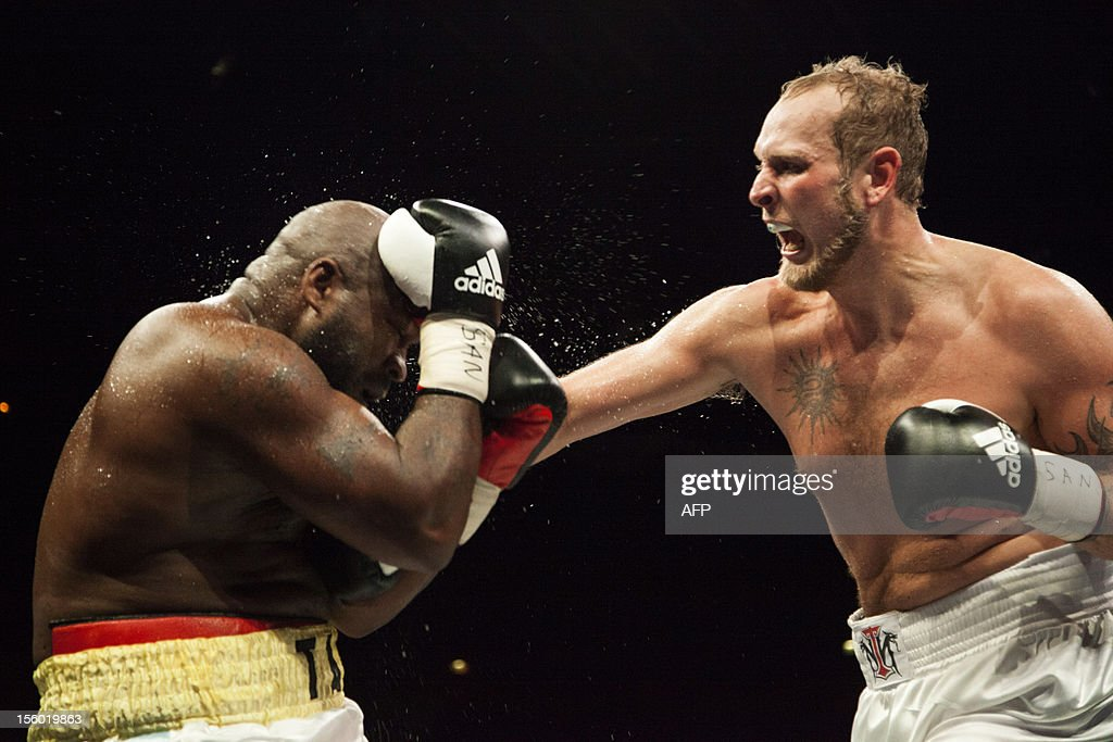 Finish boxer Robert Helenius (R) fights with Sherman Williams of the Bahamas (L) during the WBA Inter-Continental heavy-weight boxing fight on November 10, 2012 in Helsinki, Finland.