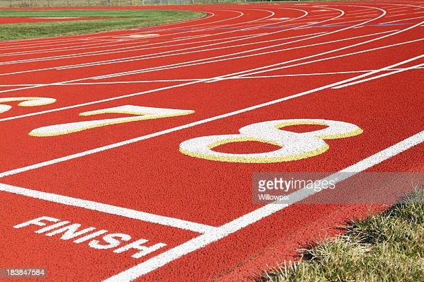 Finish Line and Beyond on Red Running Track
