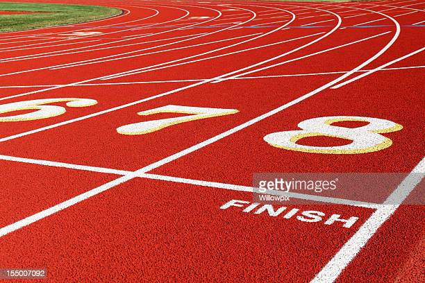 Finish Line Lanes on Red Running Race Track Closeup