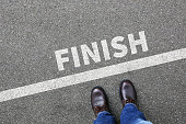 Finish line winning success running race businessman business man concept career goals motivation vision