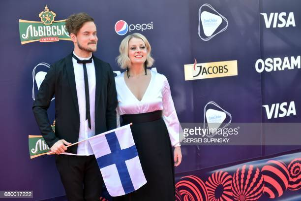 Finish music group Norma John composed by pianist Lasse Piirainen and singer Leena Tirronen pose with Finland's national flag during the Red Carpet...