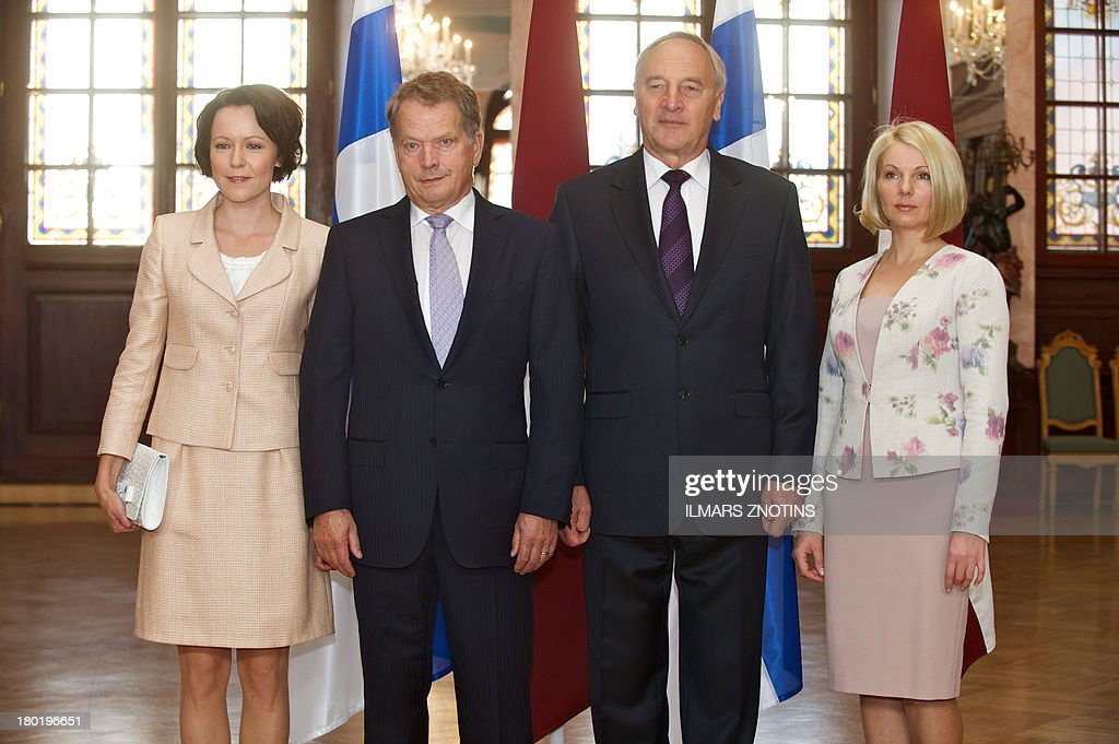 Finish President's wife Jenni Haukio, Finish President Sauli Niinisto, Latvian President Andris Berzins and his wife Dace Seisuma pose for a family picture in Riga, Latvia, on September 10, 2013. The Finnish President met today his Latvian counterpart during his official visit in Riga. ZNOTINS