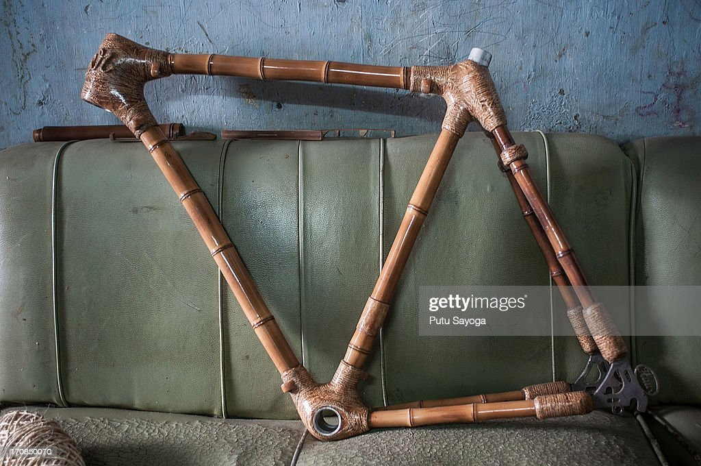 A finished bamboo bike frame is displayed on a sofa on June 19, 2013 in Bandung, Java, Indonesia. Two friends, Abah and Gun Gun Gunawan converted Abah's small guest room into a workshop in the Neglasari district in order to make bamboo bikes with sustainable phyllostachys aurea bamboo using DIY tools. They have named their product 'Haur Bike'.