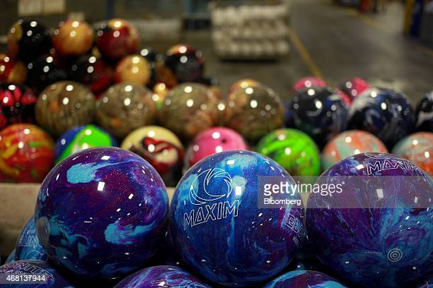 Finished bowling balls sit in piles before being packaged and shipped at the Ebonite International manufacturing facility in Hopkinsville Kentucky US...