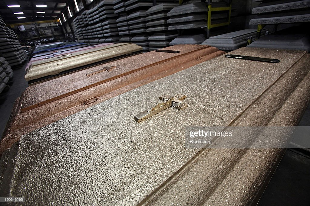 Finished burial vaults sit on display at the American Wilbert Vault Corp. manufacturing facility in Des Plaines, Illinois, U.S., on Thursday, Aug. 23, 2012. Several U.S. Presidents including John F. Kennedy and Ronald Reagan, and other famous people including Al Capone, Louis Armstrong, Elvis Presley and Frank Sinatra are buried in American Wilbert burial vaults, according to the company. The U.S. Census Bureau is expected to release data on orders for durable goods on Aug. 24. Photographer: Tim Boyle/Bloomberg via Getty Images