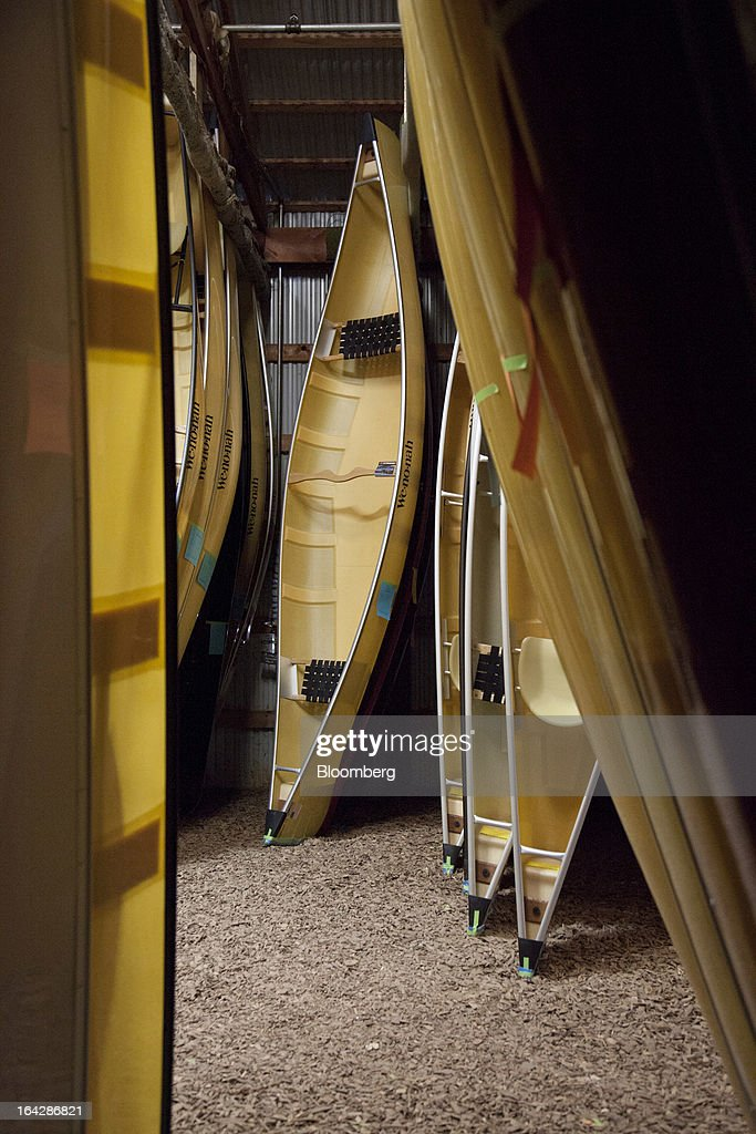 Finished canoes stand in the warehouse at the Wenonah Canoe factory in Winona, Minnesota, U.S., on Thursday, March 21, 2013. Wenonah Canoe, the second largest user of Kevlar fabric after the U.S. military, produces roughly 2500 canoes and 4000 kayaks each year. Photographer: Ariana Lindquist/Bloomberg via Getty Images