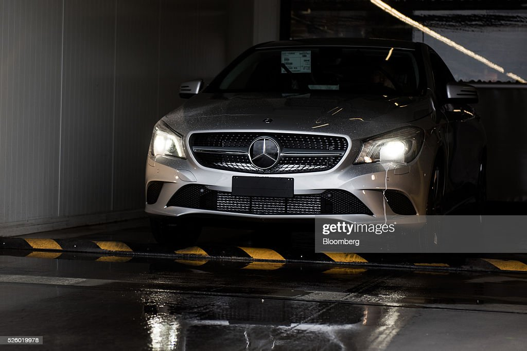 A finished CLA-class automobile drives out to the delivery area at the Mercedes-Benz AG automobile plant, operated by Daimler AG, in Kecskemet, Hungary, on Friday, April 29, 2016. Daimler's Mercedes factory will produce a new generation of compact vehicles, totalling Daimlers investment in Hungary to more than $1.8 billion. Photographer: Akos Stiller/Bloomberg via Getty Images