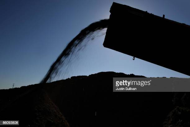 Finished compost if moved off of a conveyor belt into a pile at the Jepson Prairie Organics compost facility April 20 2009 in Vacaville California...
