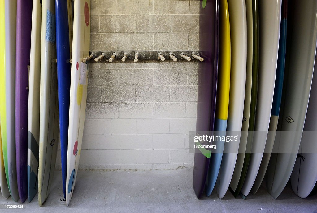 Finished custom Becker Surfboards, right, wait for delivery at the Mangiagli Manufacturing facility in Hermosa Beach, California, U.S., on Monday, July 1, 2013. The U.S. Census Bureau is scheduled to release factory orders figures on July 2. Photographer: Patrick T. Fallon/Bloomberg via Getty Images