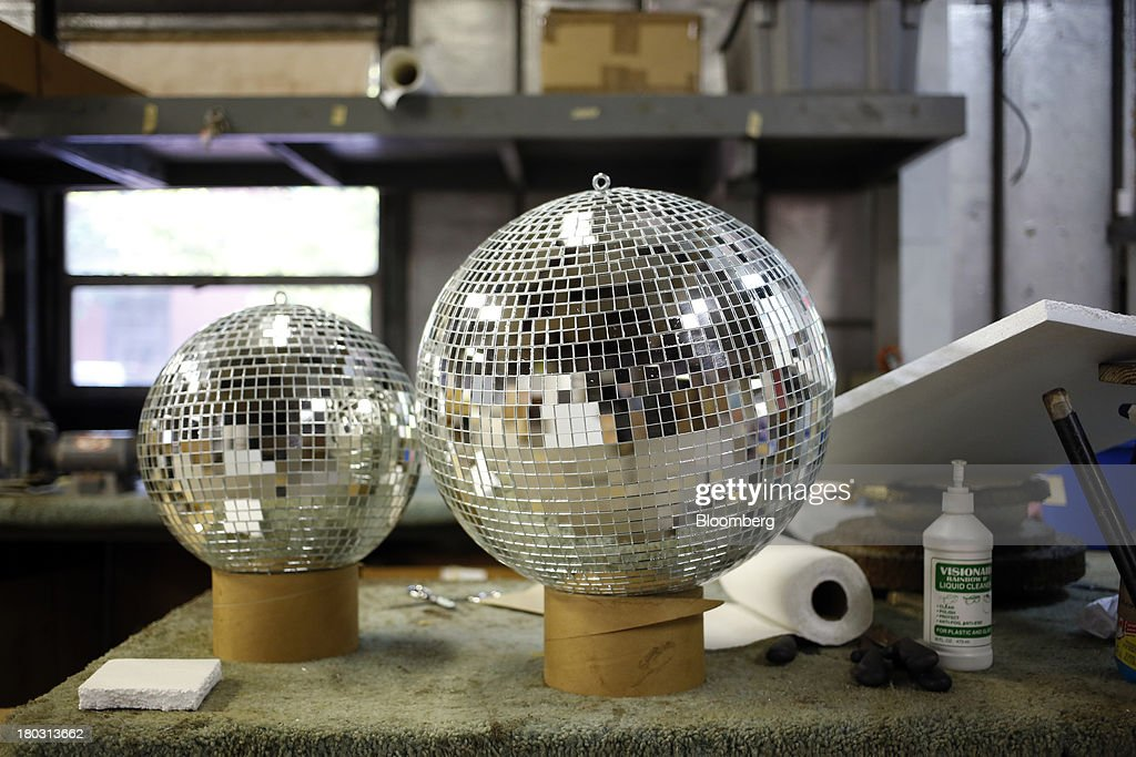Finished disco balls sit at the Omega National Products manufacturing facility in Louisville, Kentucky, U.S., on Tuesday, Sept. 10, 2013. The U.S. Federal Reserve is scheduled to release industrial production figures on Sept. 16. Photographer: Luke Sharrett/Bloomberg via Getty Images