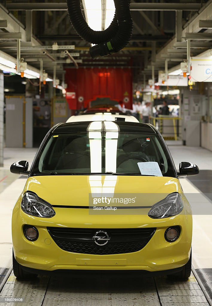 A finished Opel Adam car stands at the assembly line shortly after a celebration to mark the launch of the new Opel compact car at the Opel factory on January 10, 2013 in Eisenach, Germany. Opel employees hope the car will help the compny return to profits after years of sagging sales and the announcement of the Bochum factory closure in 2016.