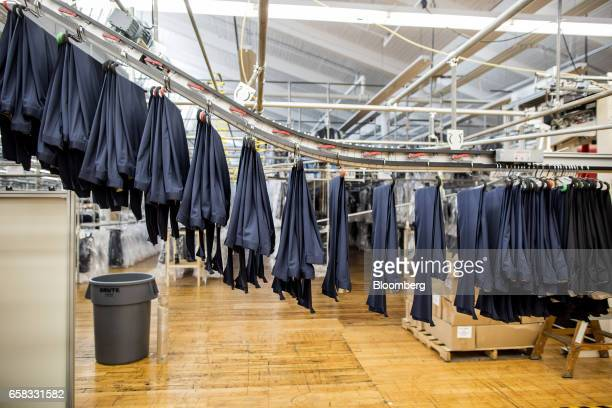 Finished pants move down a conveyor belt at the Joseph Abboud Manufacturing Corp facility in New Bedford Massachusetts US on Wednesday March 22 2017...