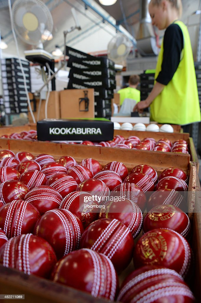 Finished red cricket balls sit in a crate as an employee packages them by hand at the Kookaburra Sports Pty Ltd. plant in Melbourne, Australia, on Tuesday, Nov. 26, 2013. Australian businesses need to boost efficiency to maintain growth in living standards, Reserve Bank of Australia Deputy Governor Philip Lowe said. Photographer: Carla Gottgens/Bloomberg via Getty Images