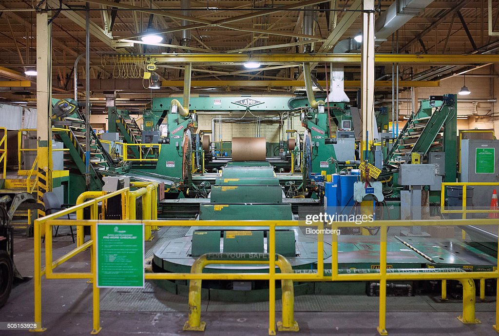 Finished rolls of newsprint paper enter the final machine that wraps them for transport at the Resolute Forest Products mill in Thunder Bay Canada...