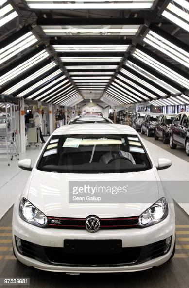 A finished Volkswagen Golf GTI prepares to drive off the assembly line at the VW factory on March 8 2010 in Wolfsburg Germany Volkswagen will...