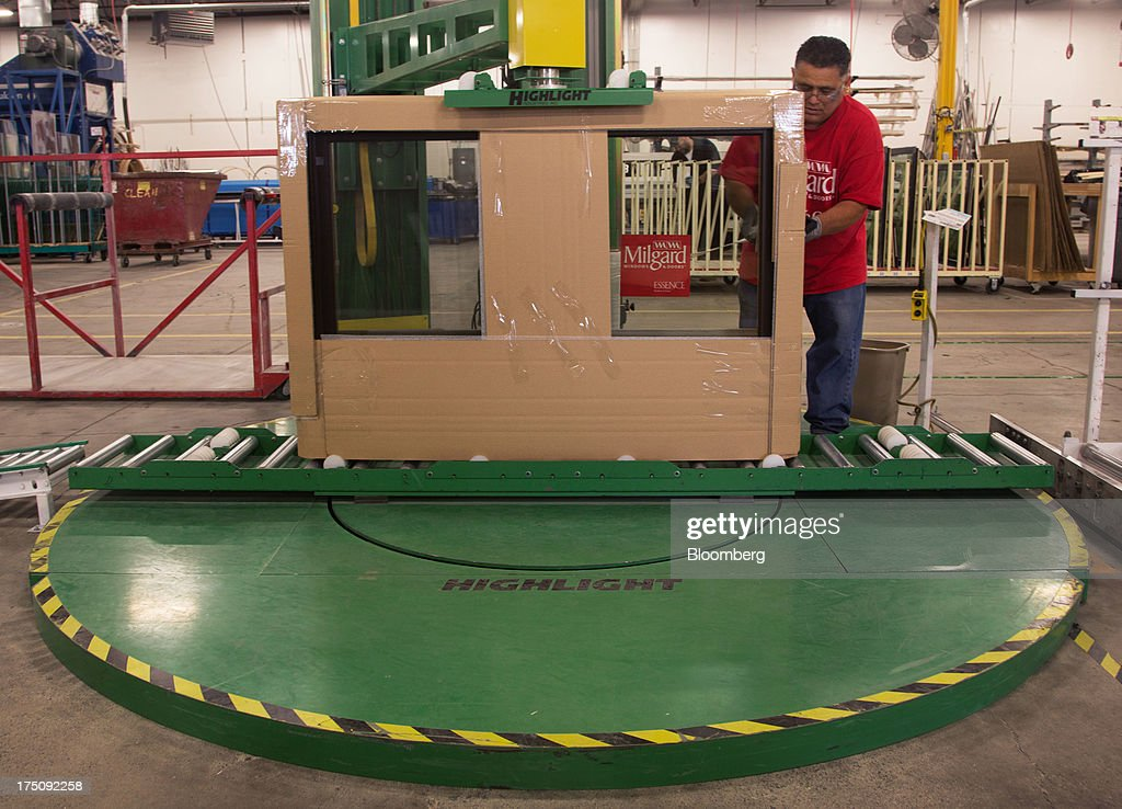Finished windows are shrink-wrapped at the Milgard Windows & Doors' manufacturing facility in Tacoma, Washington, U.S., on Wednesday, July 24, 2013. The U.S. Census Bureau is scheduled to release monthly factory orders figures on Aug. 2. Photographer: Tim Rue/Bloomberg via Getty Images