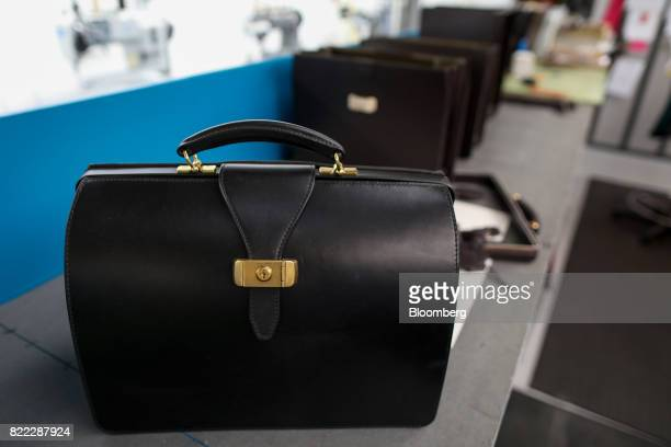 A finished Wolsley doctors bag stands on a workbench at the Alfred Dunhill Ltd London Leather Workshop in London UK on Tuesday July 25 2017 Alfred...