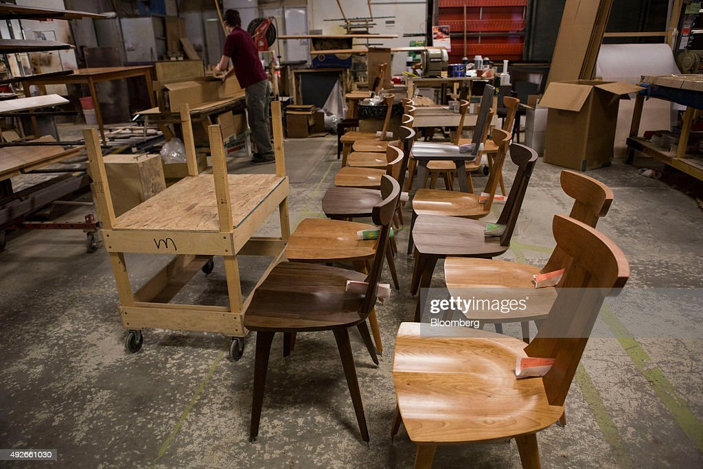 finished wooden chairs sits on the floor of the copeland furniture facility in bradford