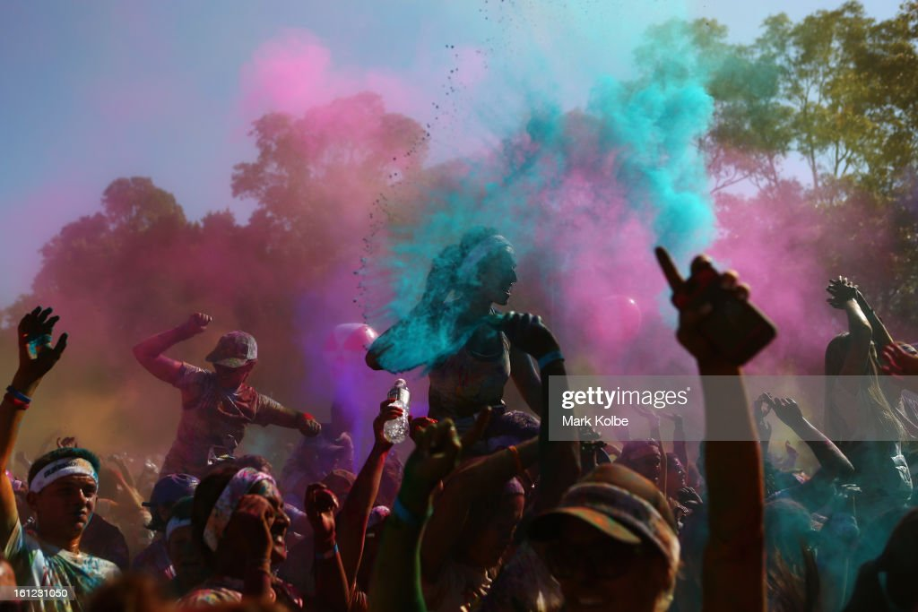 Finishers dance to a DJ set as they take part in a mass colour throw after completing the Colour Run on February 10, 2013 in Sydney, Australia.